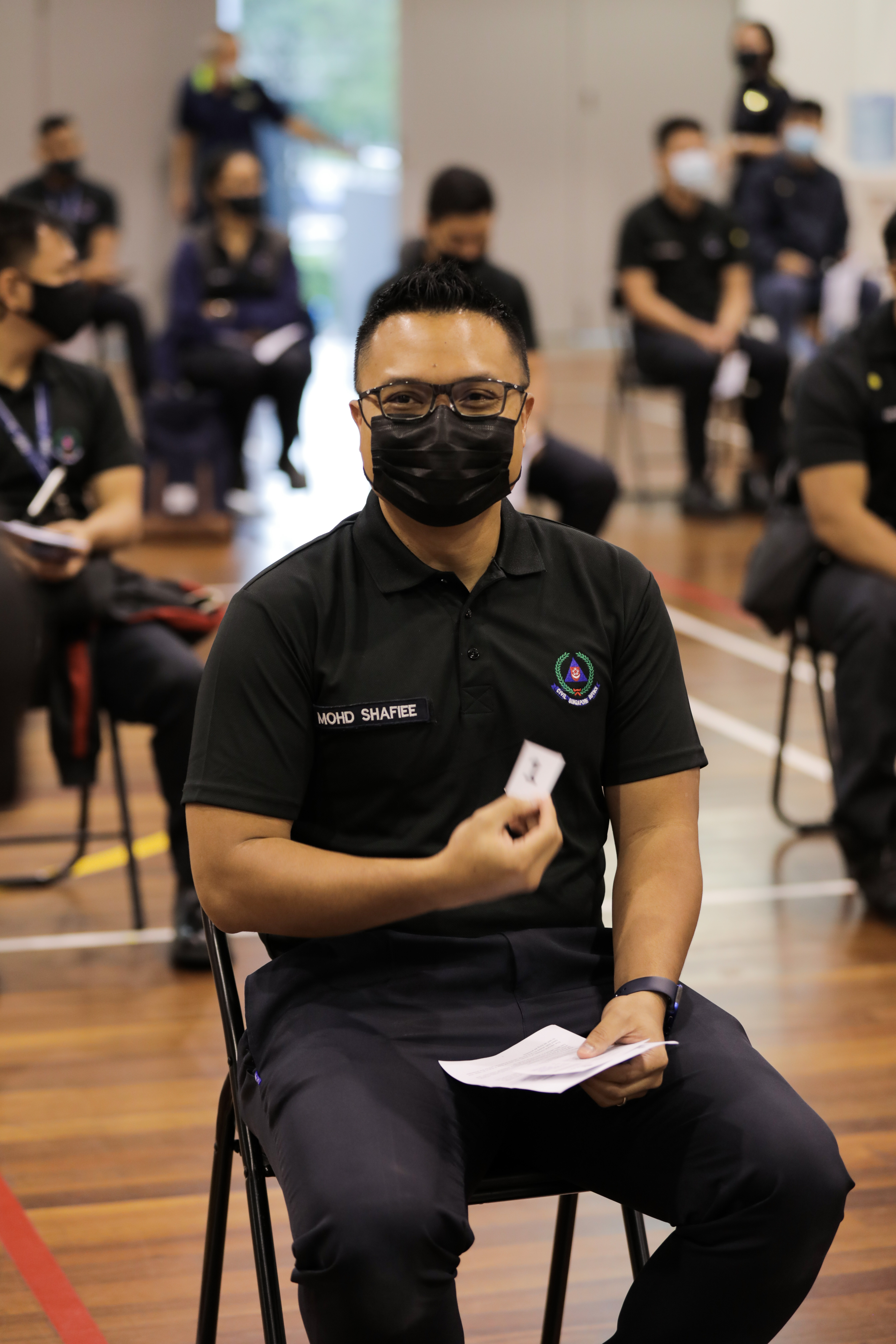 WO1 Mohamed Shafiee bin Jamin waiting in line with other SCDF officers for his turn to receive the vaccination.