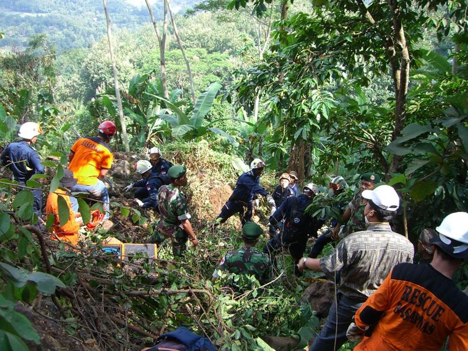 DART rescuers working with the local authorities and rescuers in search of a missing person on a mountain at Yogyakarta, Indonesia, in 2006.